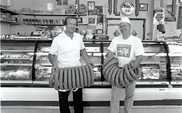 Two Kramarczuks holding a lot of sausages