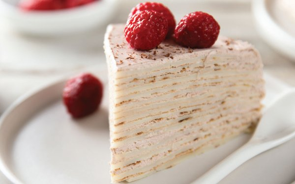 slice of cake with raspberries on it