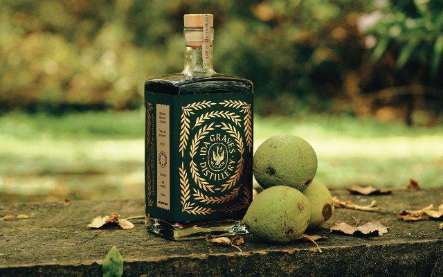 Italian black walnut liqueur next to black walnuts