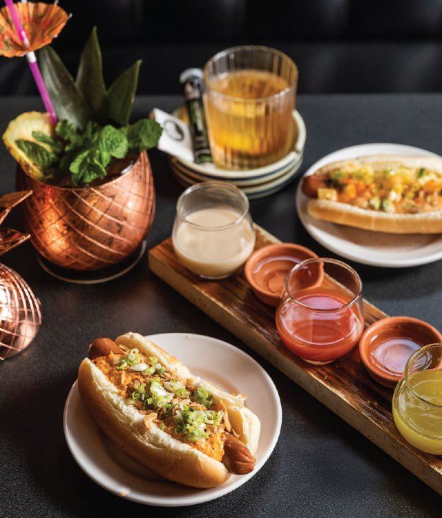 hotdogs with lots of toppings and cocktails