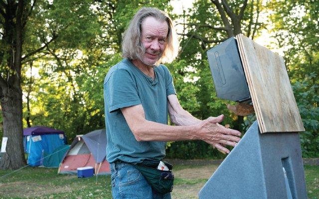 Homeless man named Sam washing his hands