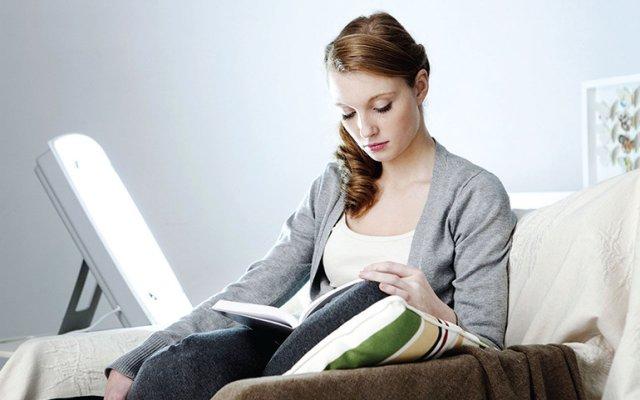 Woman reading with seasonal light