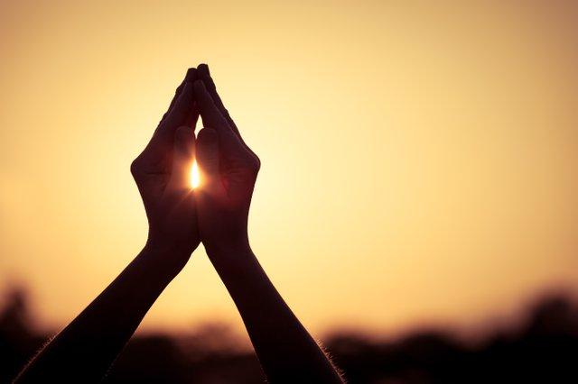 Hands Raised in Gratitude