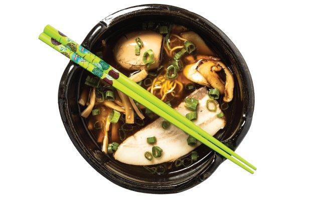 Ramen bowl with green chop sticks