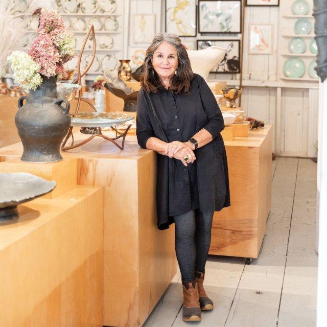 Connee Mayeron Cowles displays pottery