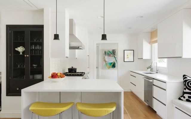 kitchen counter with yellow stools