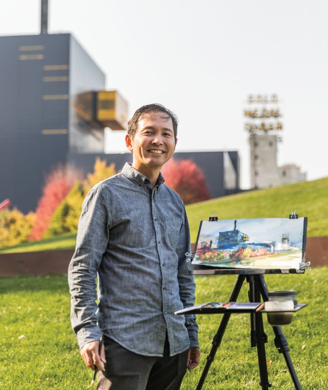 Kar-Keat Chong by his city scape watercolor of downtown Minneapolis