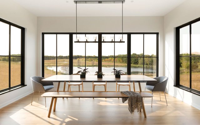 Dinning room with lots of windows looking out on a lake