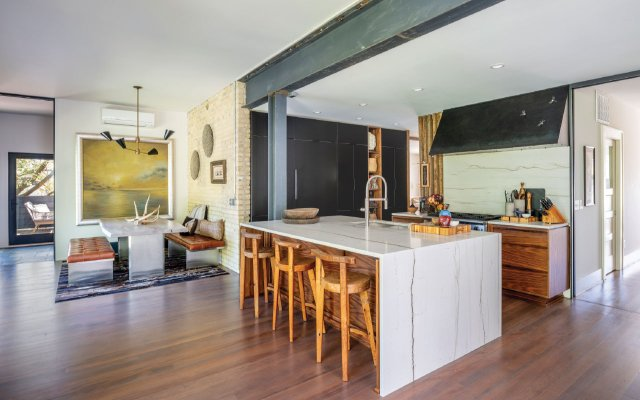 modern kitchen with a steel I-beam header and a marble counter