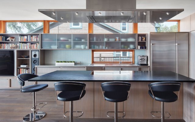 modern kitchen with black counter tops and black stools