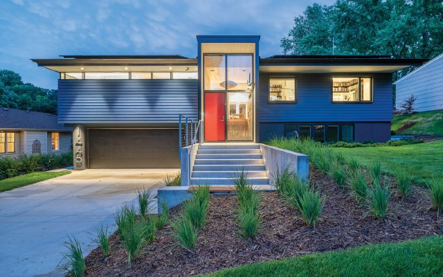Modern house exterior with orange door