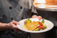 Mason Jar Kitchen's Chef Blanco with freshly prepared fish.