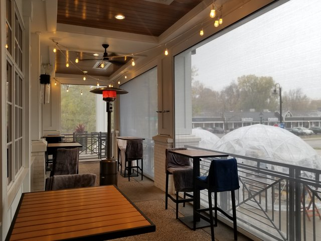 Outdoor dining on ninetwentyfive's heated porches
