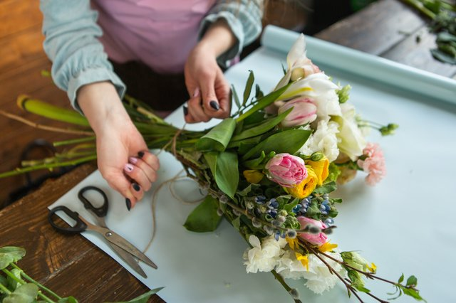 Florist Creating Flower Arrangement