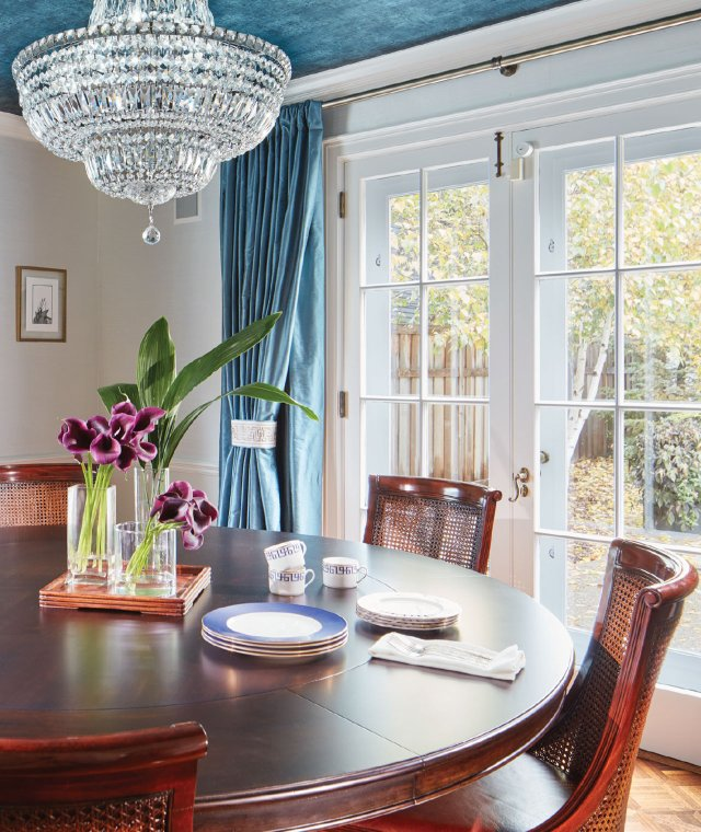 dining room with round table and chandelier