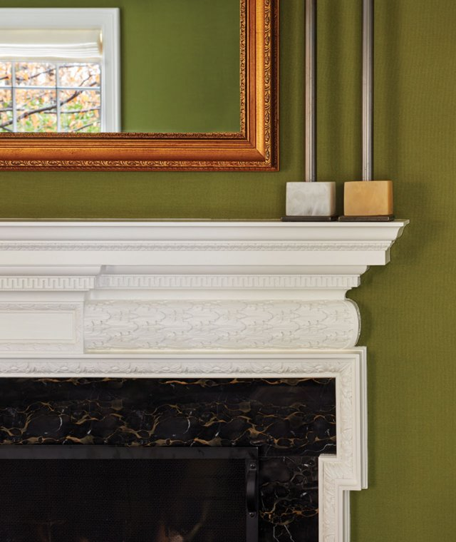 White mantle with green walls and mirror