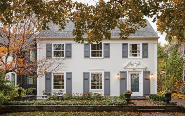 two story colonial-style house white with grey trim