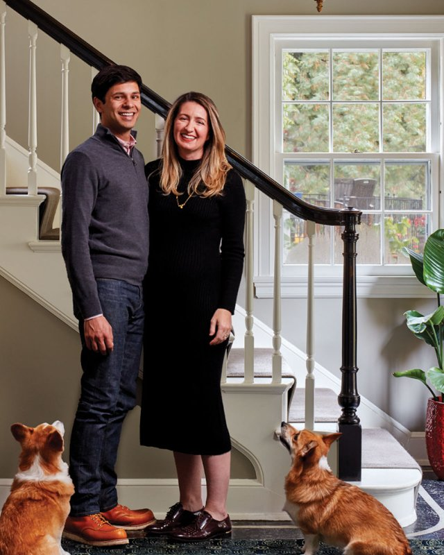 Sanjiv Laud and Catlan McCurdy infront of stairway with two dogs