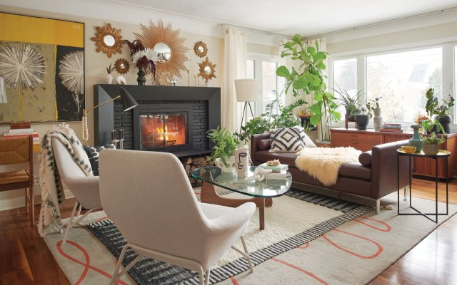 modern living room with roaring fire in fireplace