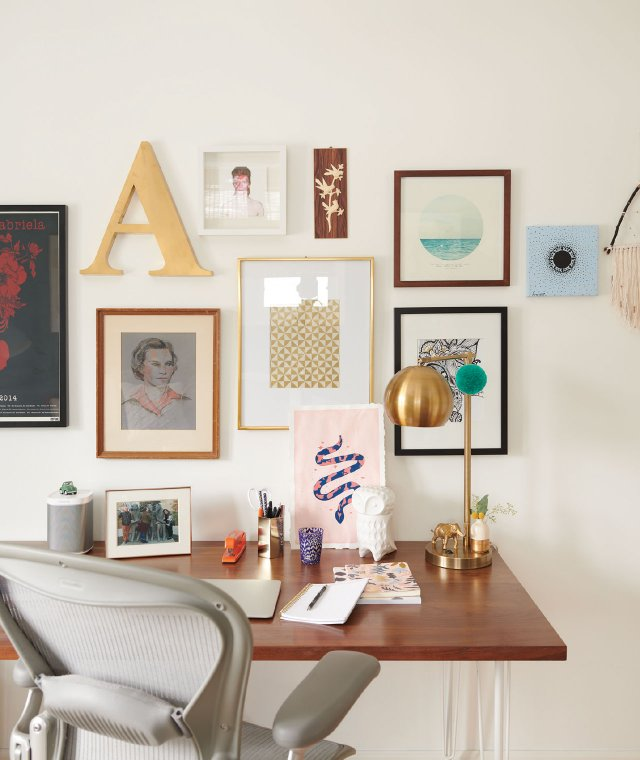 Office with eclectic art on the wall