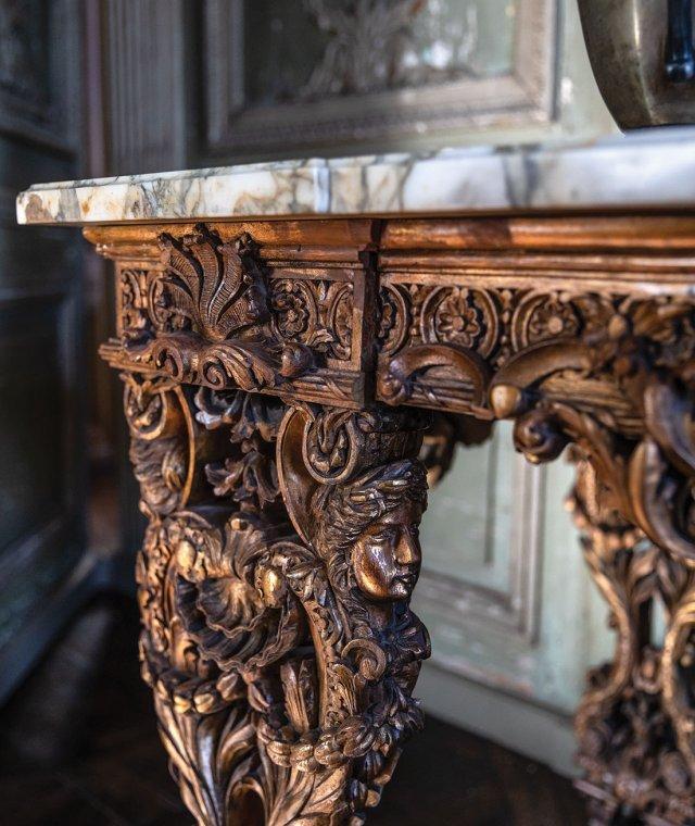 ornate gold carved table leg