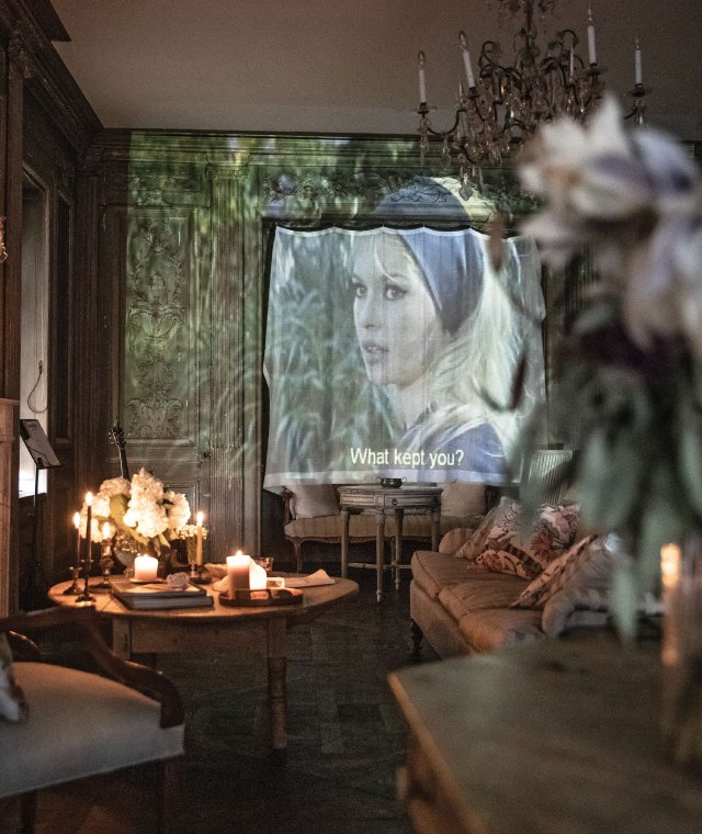 Brigitte Bardot movie projected on wall