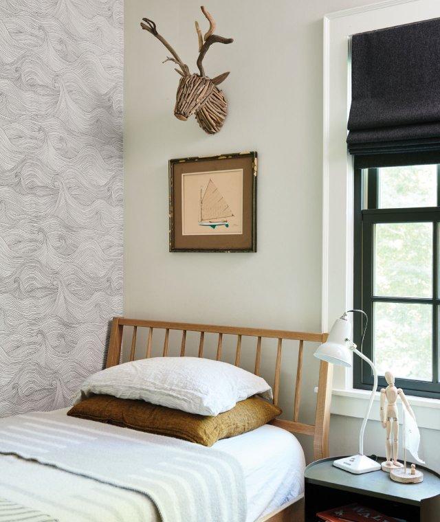 bedroom with mock deer head