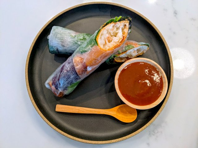 shrimp rolls on plate with sauce
