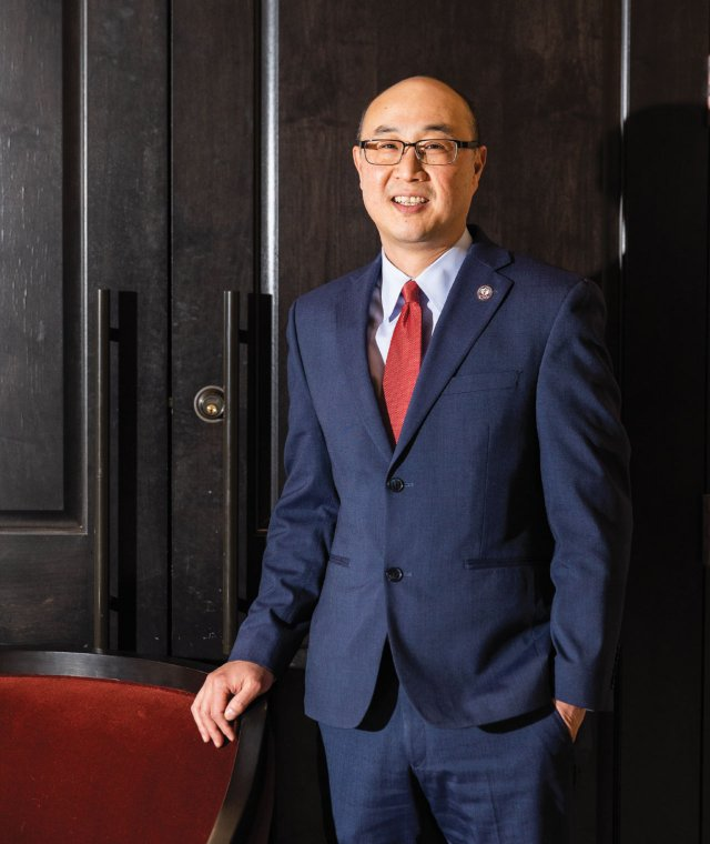 Attorney John Choi standing with hand in pocket