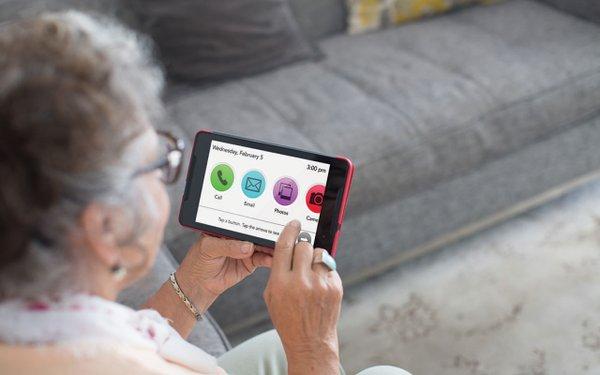 Senior looking at a phone screen