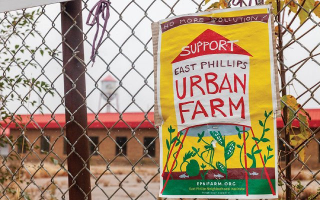 Sign on chainlink fence asking for support of urban farming