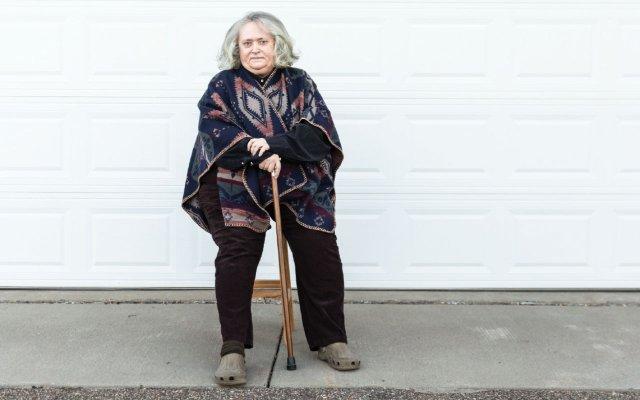 Ellen Hart seated outside