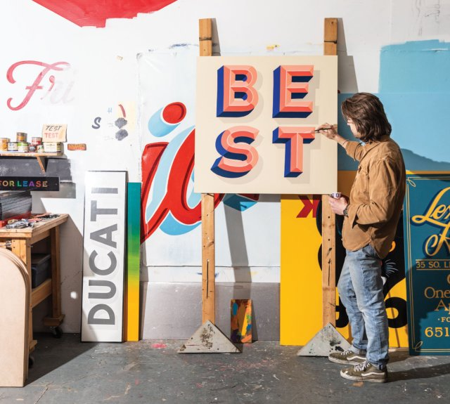 sign painter painting the word BEST