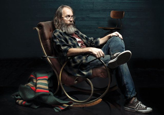 Charlie Parr sitting in a rocking chair