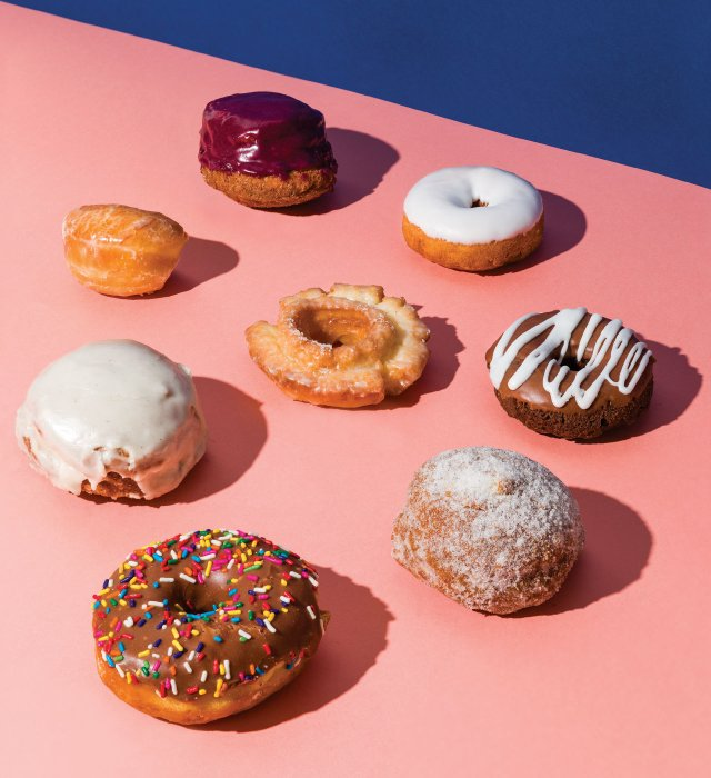 And assortment of donuts on a pink background