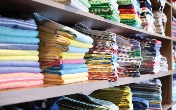 Stacks of linens on shelves