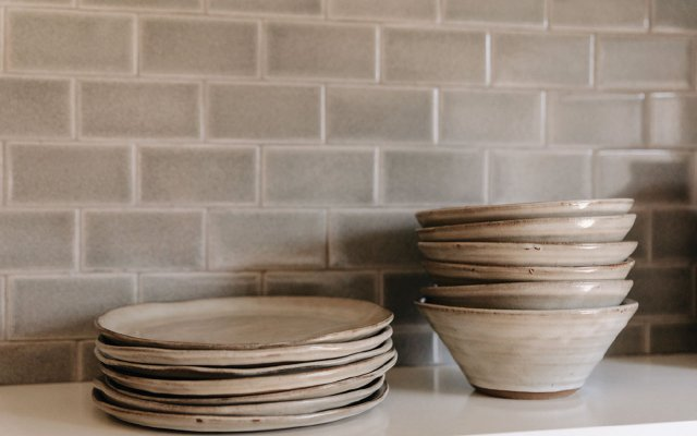 stack of bowls and a stack of plates