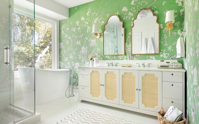 bathroom with deep soaking tub by window and green wallpaper