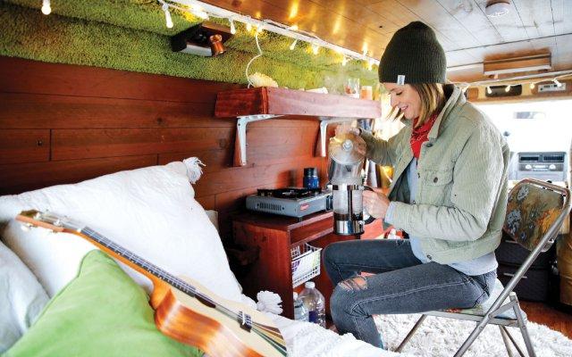 woman making coffee in a van