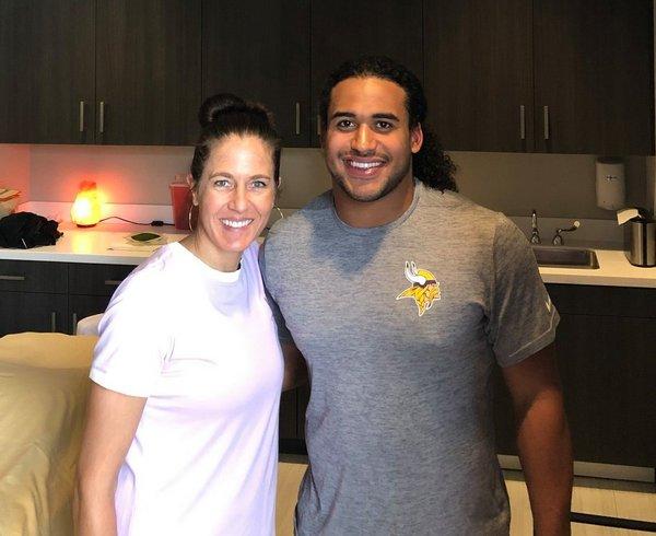 Hilary Patzer of JADA Studios with Eric Kendricks of the Minnesota Vikings