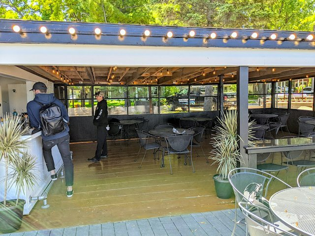 screened in porch with lights and bar