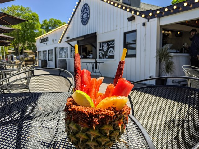 pineapple with fruit on the deck