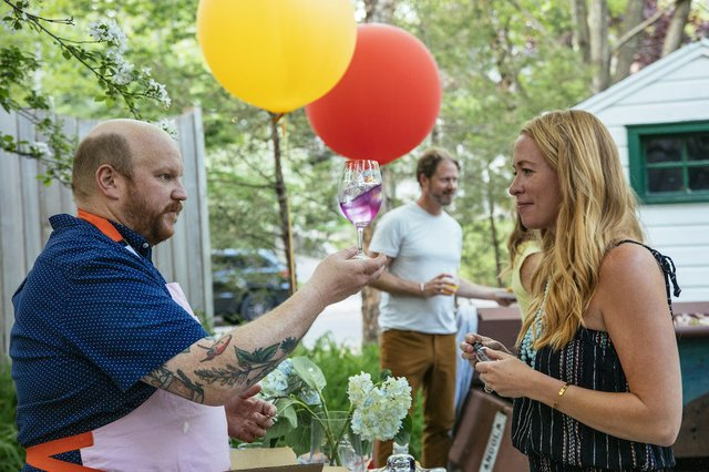 man and woman with drinks and balloons