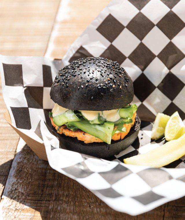 Salmon burger with a black bun