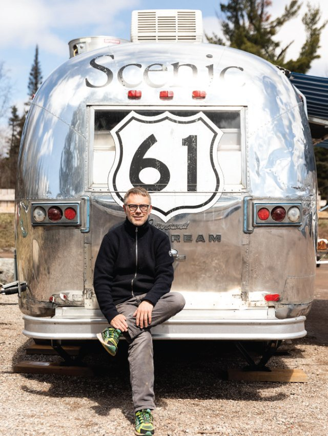 Chef Scott Graden with one of the three vintage Airstream trailers