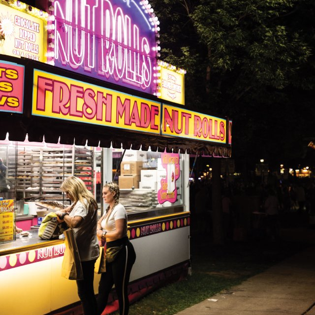 Two women at a food booth
