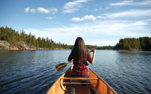 girl in the front of a canoe