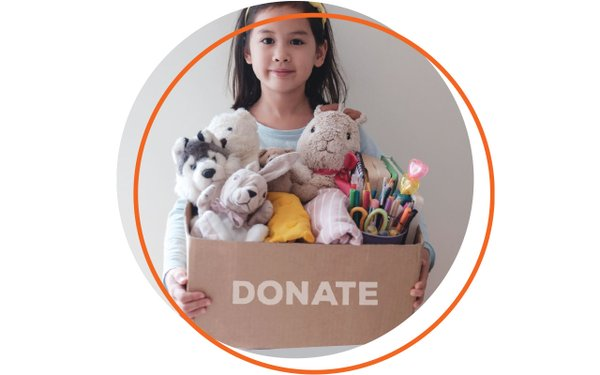 Girl with box of stuffed animals