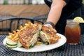 Grilled Turkey Apple Brie sandwich, served on the Mason Jar Kitchen patio.