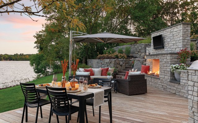 Outside living space with fireplace and TV
